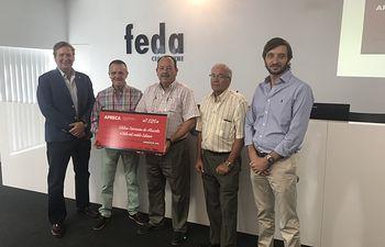 Fotografía de APRECA entrega a Cáritas 7.020 euros por las ventas de vehículos en la XVIII Edición de Ferimotor.