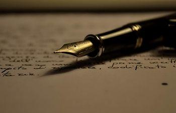 Escritorio - Pluma.
