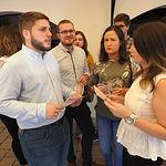 El secretario regional de JJSS, Nacho Hernando, y el secretario regional de Universidad del PSOE, Manuel Martínez, presentan la campaña de bienvenida a la universidad, en la caseta 'La Roja' del Recinto Ferial