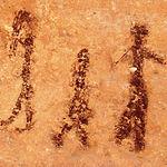 Figuras humanas, representativas de la pintura rupestre del Arte Levantino, en el Abrigo Grande de Minateda.