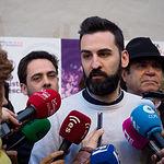 José Antonio Peñaranda, número tres al Congreso por Unidas Podemos en Albacete, durante la tradicional Pegada de Carteles de las Elecciones Generales del 28A